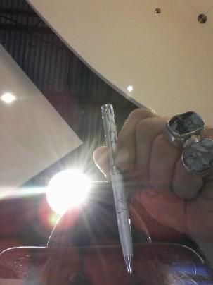 poet holding Celine Dion pen